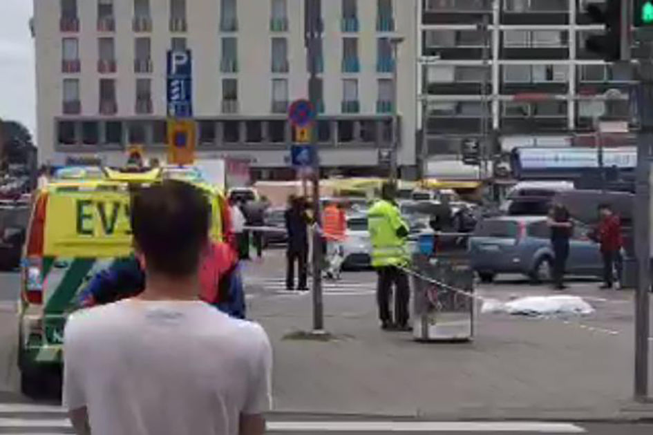 "A video grab taken from Twitter on August 18, 2017 shows officials standing in a street in the Finnish city of Turku where several people were stabbed. ""Police shot the suspected perpetrator in the legs,"" police wrote on Twitter. ""The person has been arrested. We recommend that people avoid central Turku / AFP PHOTO / Juha Riihimaki (Photo credit should read JUHA RIIHIMAKI/AFP/Getty Images)"